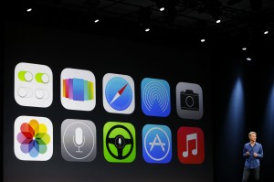 New Apple iOS 7 features are displayed on screen during an Apple developers conference earlier this year in San Francisco.