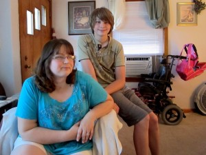 Brady Spencer sits with her son Brendon. Brendon has Asperger's, ADHD, and mood disorders. A few years ago she decided to take him out of his local public school, where he would often be sent to the hallway or a spare office during class. He now goes to a charter school for special needs kids.
