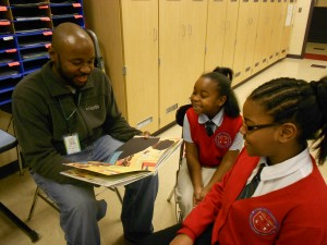 Dan Crsoby reads to his daughters at Warner Girls Leadership Academy in Cleveland.