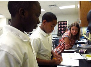Toledo 7th grade teacher Emily Brown helps students with a science experiment on the motion of waves. Brown has been rated most effective in math twice, and most effective than average in reading.