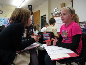 Akron fourth graders discuss non-fiction articles during English class.